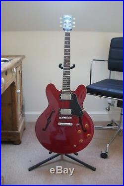 Vintage semi-acoustic electric guitar, cherry red